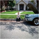 Mid-Summer: Girl Sitting on Curb with Car